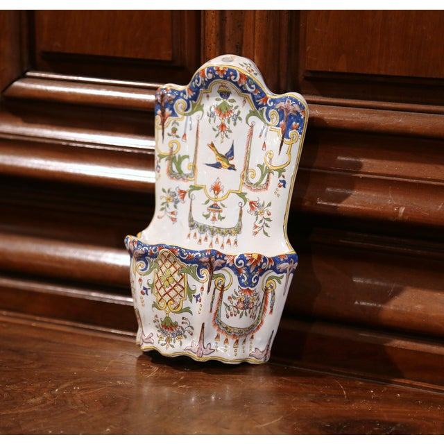 Elegant antique letter holder from Normandy, France; crafted circa 1870, the colorful wall piece features hand painted...