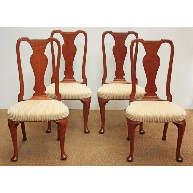A group of four carved / shaped mahogany Georgian / Queen Anne style side chairs with shaped front (cabriole) and rear...