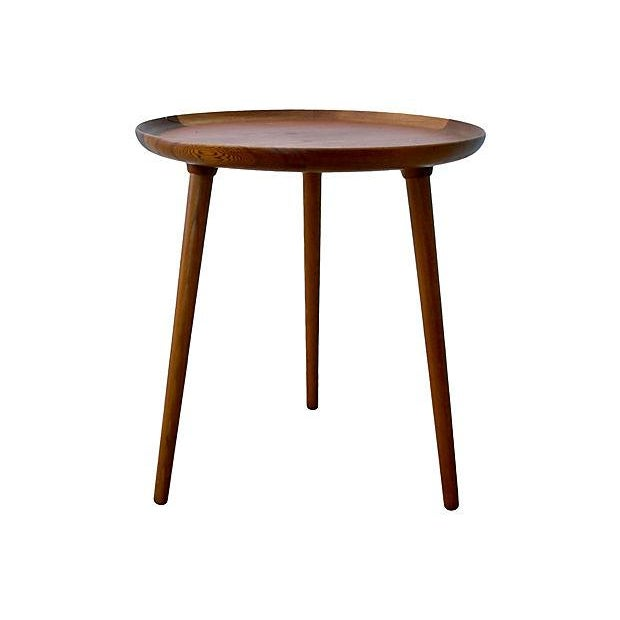 This is a Danish modern teak and walnut tray-style side table. The table legs and main surface are teak with edge detail...