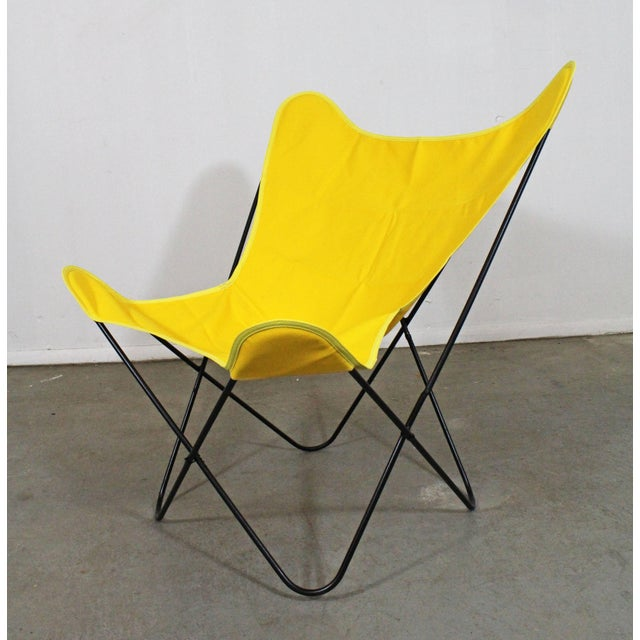 Offered is a welded iron 'Butterfly' chair, similar to the style of Knoll. It is in good condition, has been repainted and...