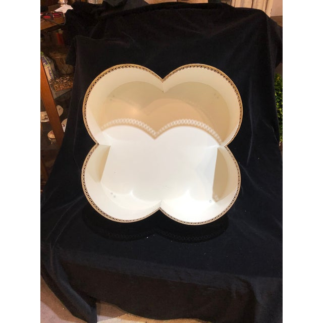 """White / Gold Clover Shape Cachepot With Feet. 20"""" W x 20"""" L x 7.5"""" H. A great tabletop styling piece!"""