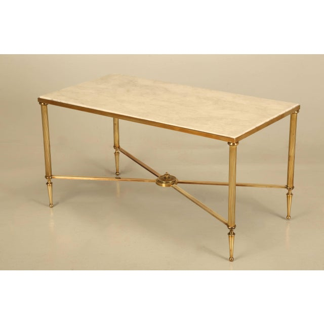 Vintage French, Mid-Century Modern coffee or cocktail table. Generally, there petite coffee tables have just a brass...