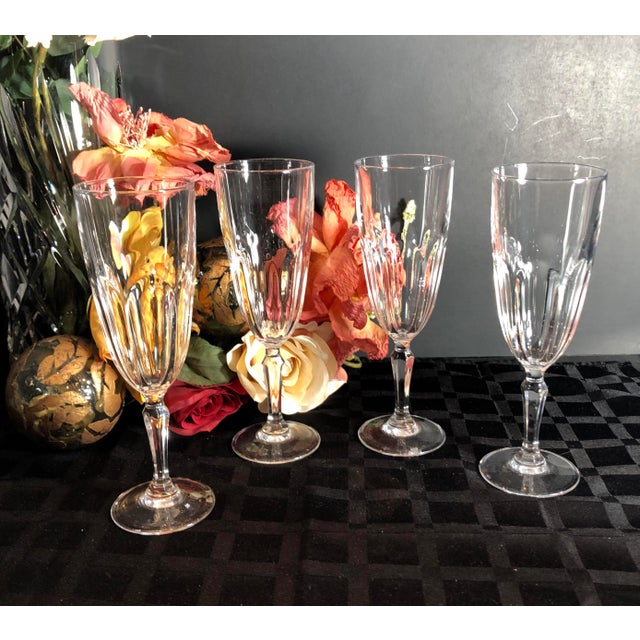 This is for a set of 4 traditional champagne glasses in the Washington pattern by Cristal D'Arques-Durrand. These were...