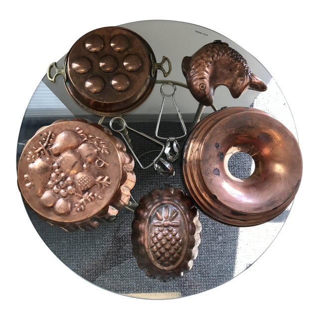Copper escargot kitchen collection with tongs and pineapple, bundt, and fish