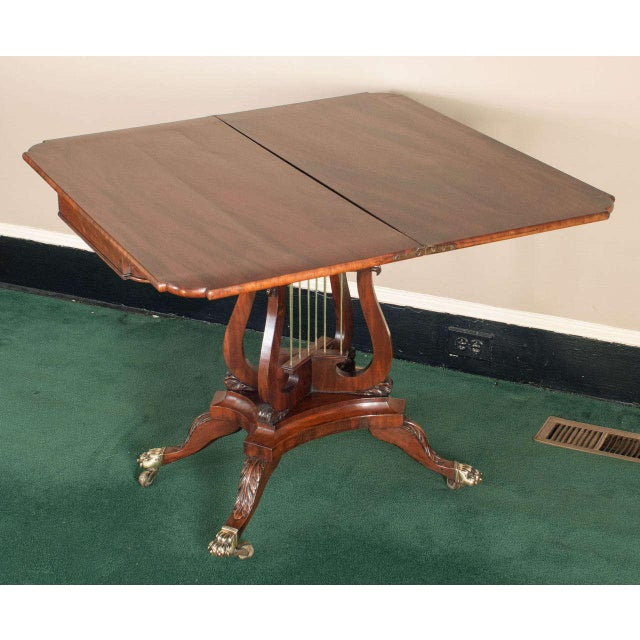 This exceptional Philadelphia games table was the product of a master cabinetmaker - the burled elm inlay is highly...