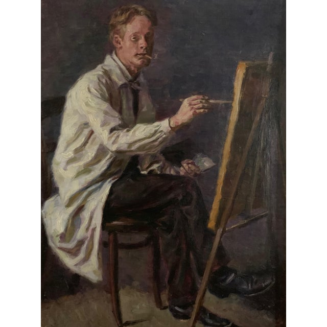 A perfect scale self-portrait painting of an artist at his easel, smoking a pipe. It is signed illegibly - dated 1905....