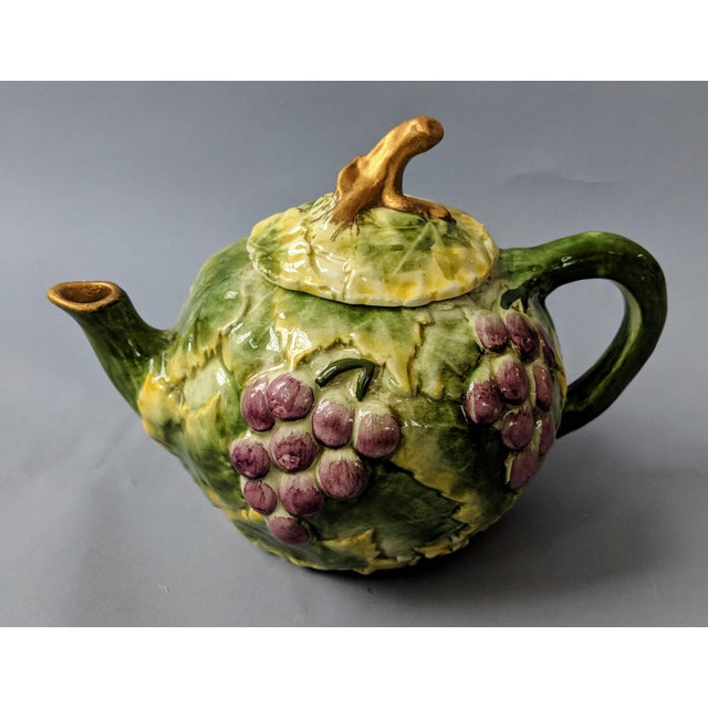 This ceramic teapot from San Marco, Italy features a grape and grape leaf motif and is in excellent condition with no...