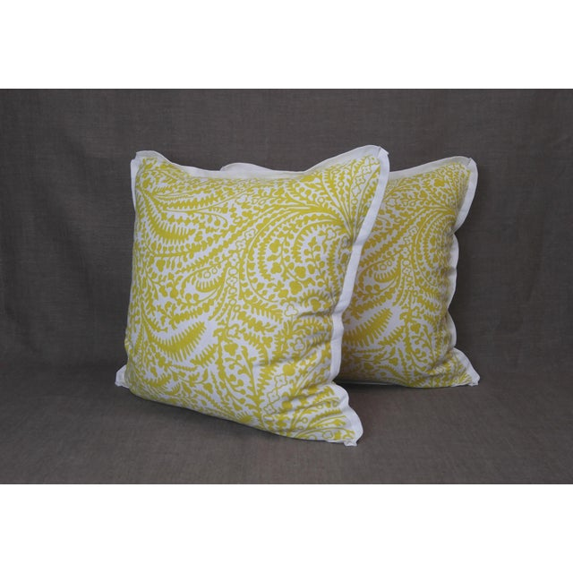 Pair of Raoul Textiles throw pillows in Arcadia Linen Print, Sulphur colorway on white, flat welt with pinched corner and...