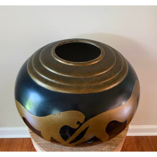 A gorgeous large vintage ceramic vase with gold parading panthers. A great display piece.