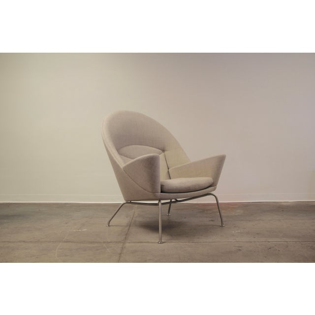 "Wegner's Oculus Chair takes its name from the Latin word for ""eye,"" in reference to the trademark eye-shaped stitching on..."