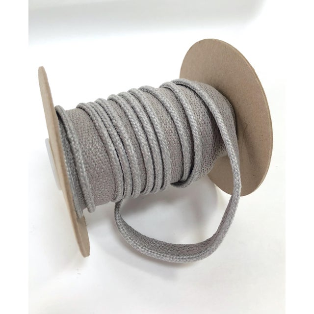 "One, 11 yard spool of 1/8"" Indoor/Outdoor braided cord trim with flange. Flange is 1/2"" wide for sewing. Total height:..."