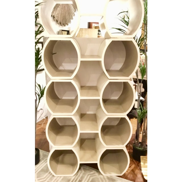 Stylish contemporary, Modern Geometric cappuccino finished Pamela bookcase, ten hexagonal side shelves and five center...