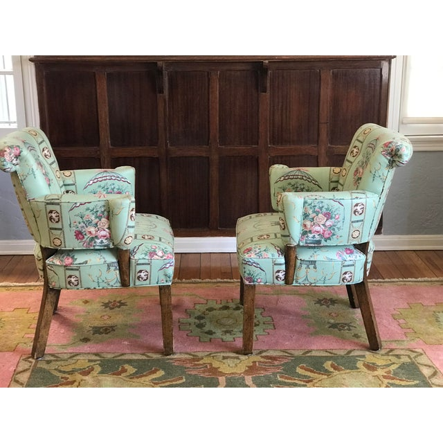 So insanely adorable vintage Lee Jofa chintz clad curvy chairs with sculptural arm and back. These chairs are total...