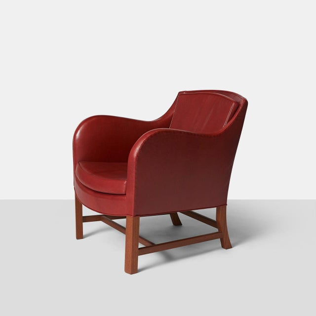"A pair of ""Mix"" lounge chairs by Kaare Klint made in the Rud Rasmussen factory. Upholstered in a deep cordovan leather..."