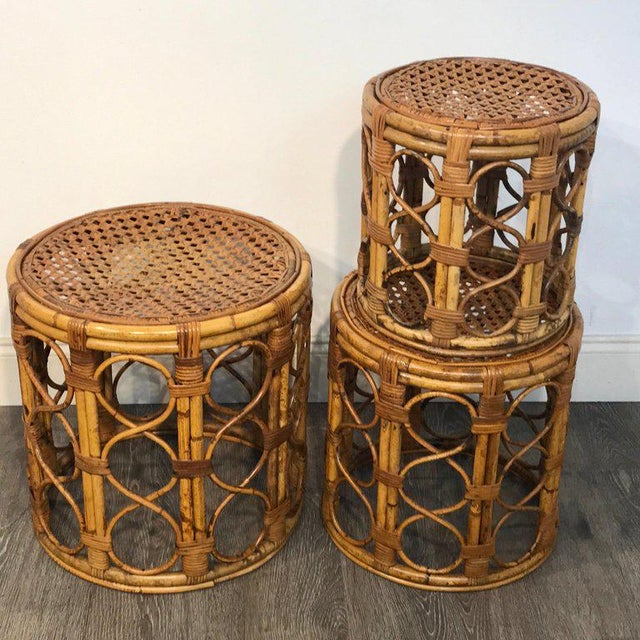 Set of three Graduating/ Nesting bamboo, rattan and reed nesting side tables, each one woven with interlocking circles and...