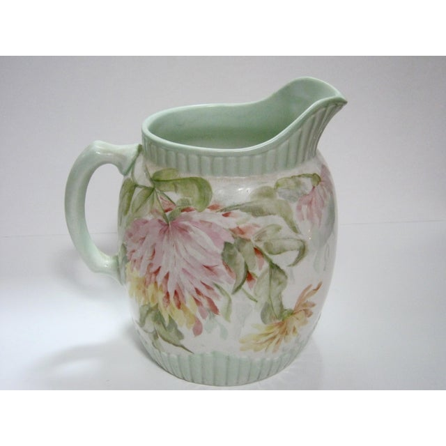 Lovely large antique hand painted floral (chrysanthemums ) pitcher with soft pastel hues of yellow, salmon and green....