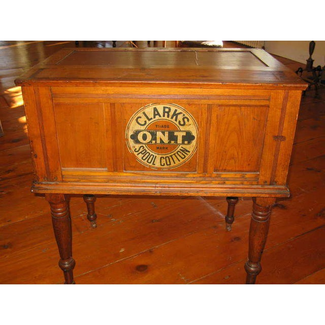 A vintage oak cabinet from a general store. Made in the 1900s.