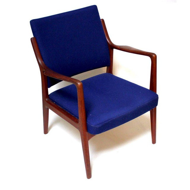 1960s Swedish modern teak lounge chair, professionally reupholstered with vivid blue Knoll fabric. In excellent condition....