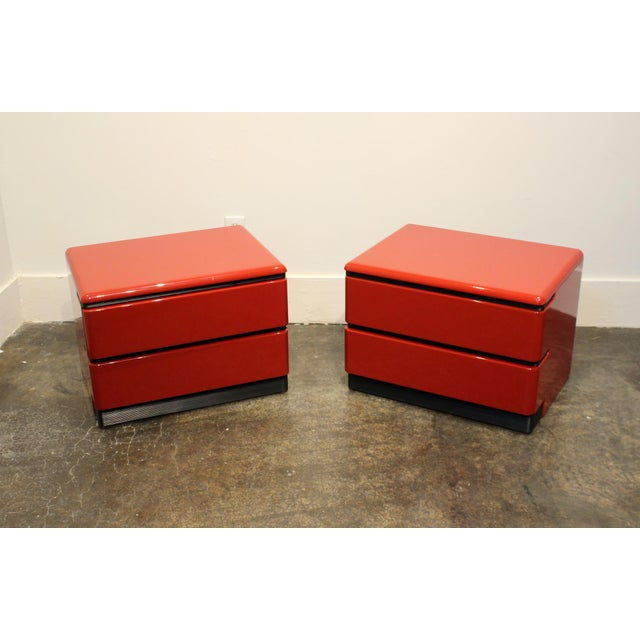 Make any room pop with this stunning pair of red lacquered nightstands with black accents by designer Roger Rougier....