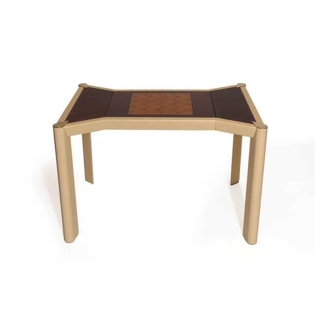 Fabulous rosewood brass and lacquered wood game table from Italy, circa early 1970s. This stunning example an almond...