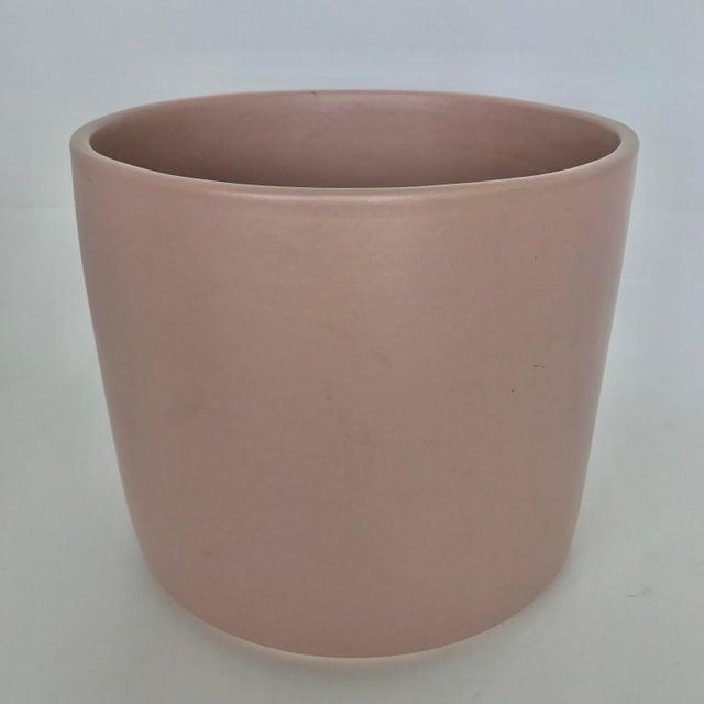 """A pink Glazed Ceramic Gainey Planter. Dimensions: 10"""" x 10"""" x 9"""""""