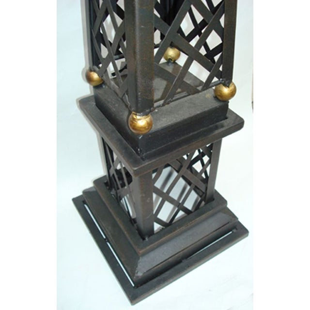 A heavy metal architectural obelisk that definitely adds a classic feel to a desk, bookshelf, mantle or patio garden......