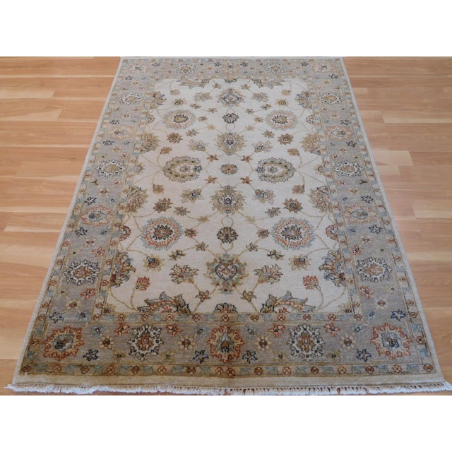 This is an Oushak design that has been produced in indian. Its wool pile and all natural dyes! Measurements are 4' x 6'.