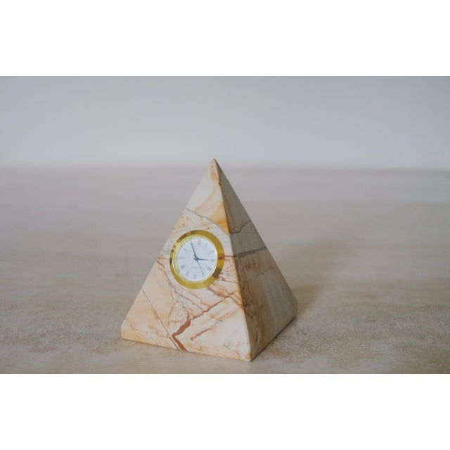 Gorgeous beige marble clock with tons of unique detail. The clock is in working condition. In order to change the battery,...