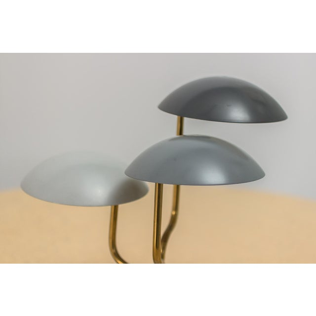 Petite organic modern table lamp, designed by Gino Sarfatti for Knoll. Three domed shades, enameled in graduated gray...