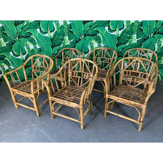 Set of 6 Brighton style rattan arm chairs. Bamboo construction with geometric design. Very good vintage condition with...