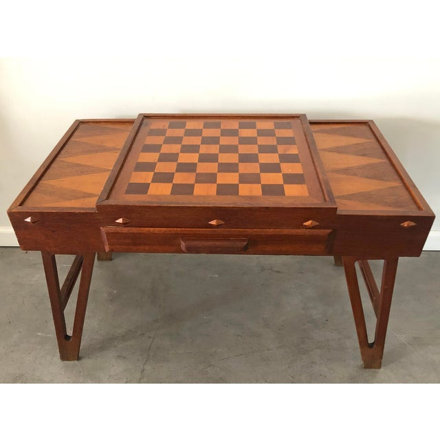 This vintage game table is simply stunning. The table features an integrated chess board / checkerboard design with 2...