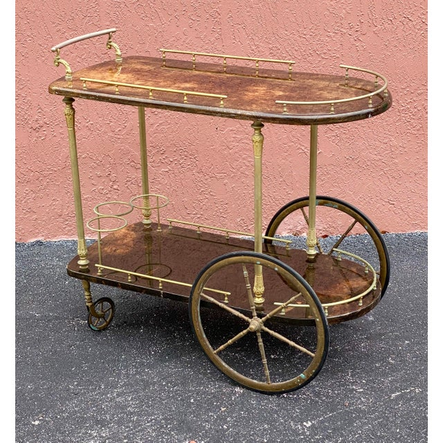 Fantastic Aldo Tura bar cart. Made in Italy. Chocolate brown wrapped goatskin. Beautiful brass hardware.