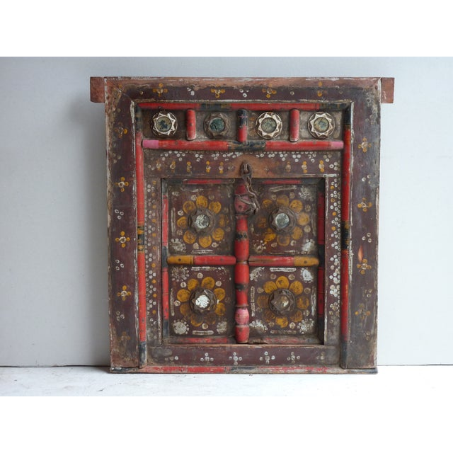 Small painted fragment of a cupboard door, with mirror decorations, ready to hang on wall.