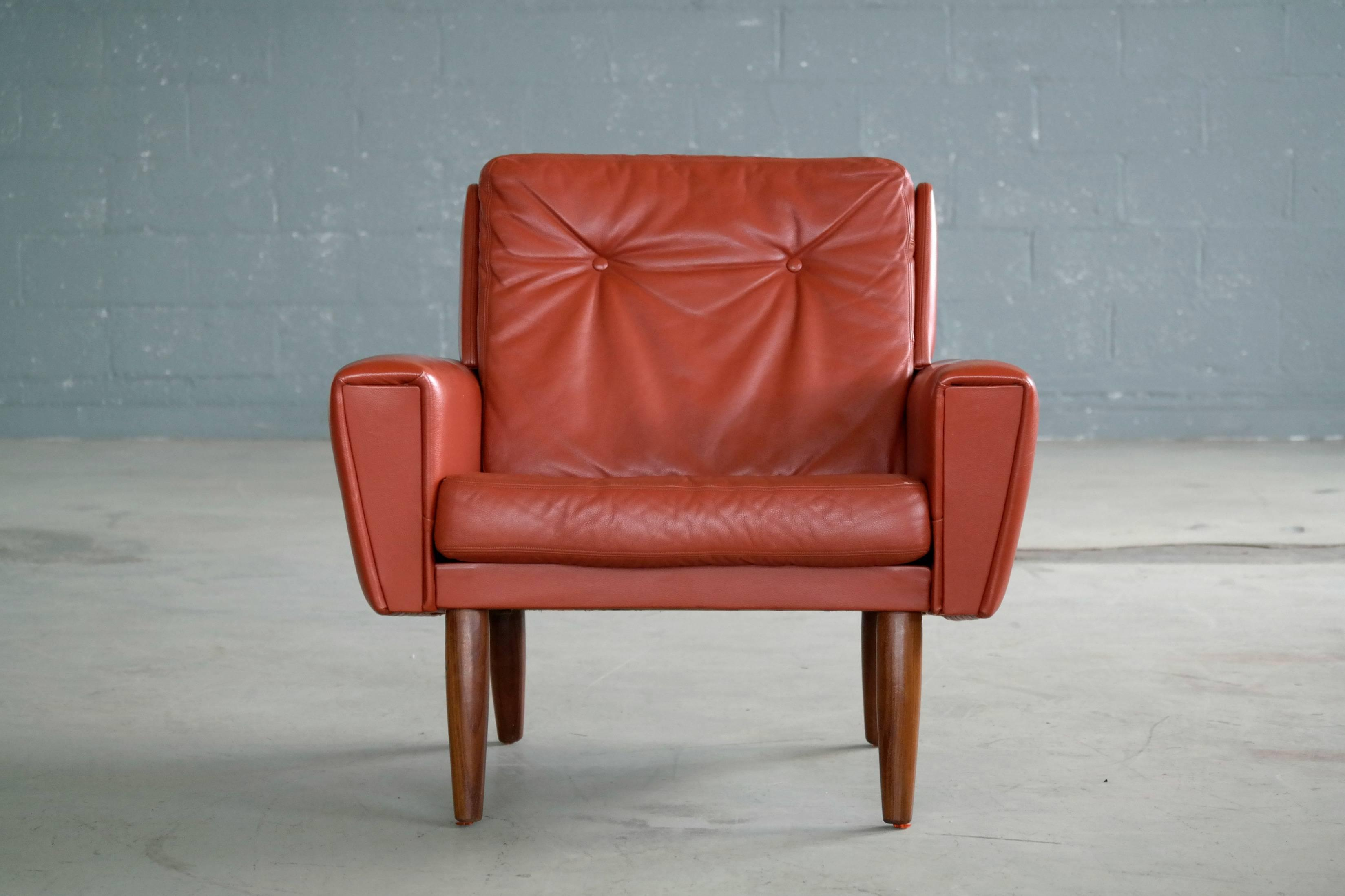 Very Cool 1960s Danish Lounge Chair In Red Leather Raised On Solid Teak  Legs. The