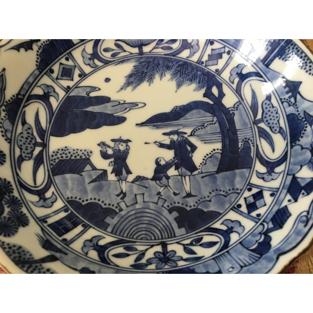 This blue and white bowl is decorated with a scene of Asian life in the 19th century. It is beautifully glazed and in mint...