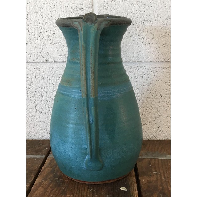 large studio pottery pitcher. Saturated turquoise in a matte glaze with ribbed texture & subtle stripes. Made in the late...