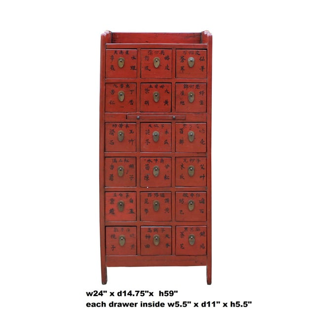 This is a vintage Chinese herb storage apothecary cabinet with 18 drawers. The center part has a pull-out plank. It is...