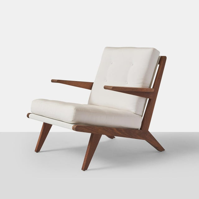 A open-arm lounge chair in teak for indoor or outdoor use with drip thru cushions. Handcrafted exclusively by Almond &...