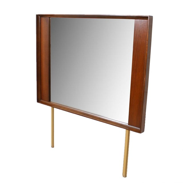 Gorgeous MCM walnut mirror that coordinates with our thin edge dresser suite by Stanley but will work well with many...