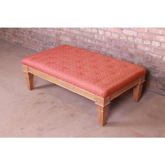"""A gorgeous vintage Louis XVI style carved giltwood upholstered bench By Baker Furniture USA, Circa 1960s Measures: 48.5""""W..."""