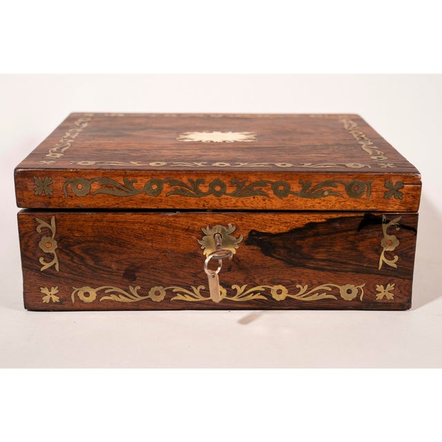 Late 19th Century Brass Inlaid Rosewood Lap Desk. This military style Victorian lap desk has multiple internal...