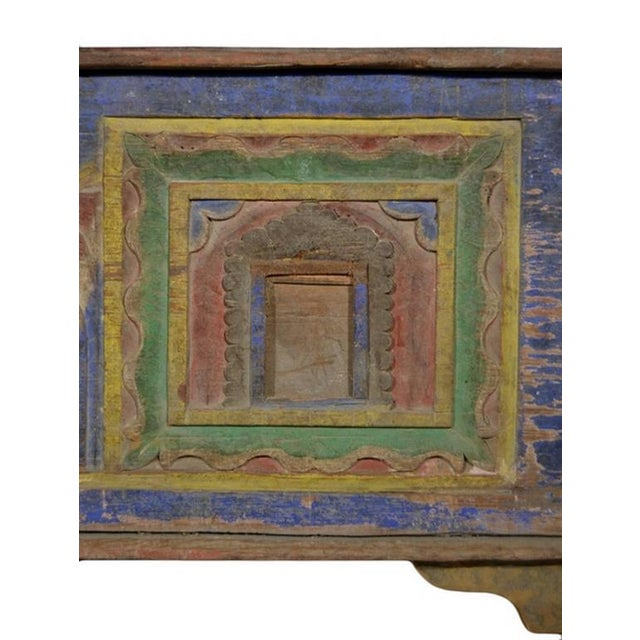 A 19th century trunk with patina of age from India, where it was hand-carved and painted. This rectangular trunk rests on...