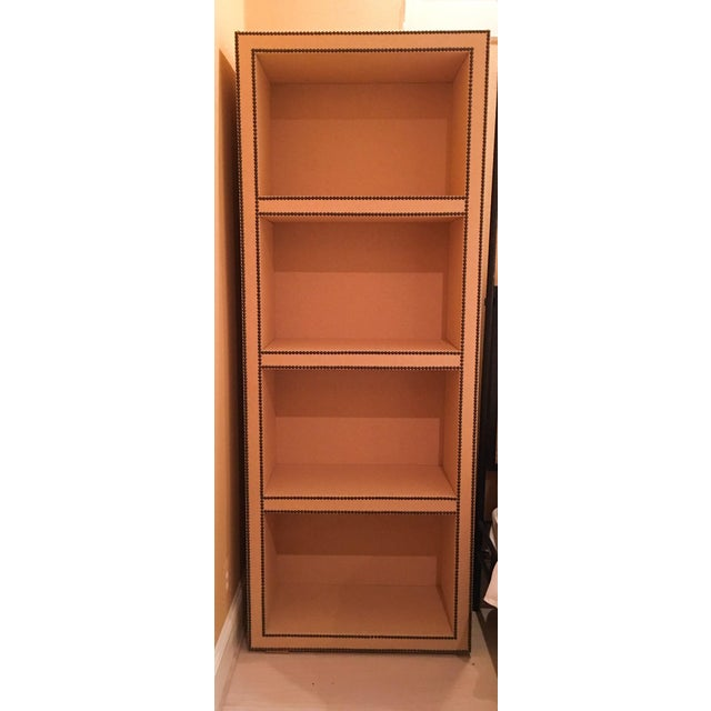 Lightly used grasscloth covered bookcase with decorative oil rubbed bronze nail heads from a show house. Overall...