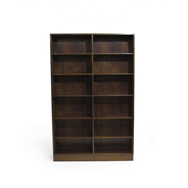 Rosewood bookcases designed by Omann Jun crafted of Brazilian rosewood with mitered edges, rosewood interior with series...