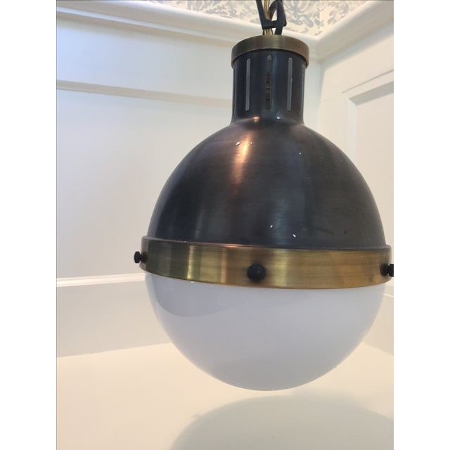 Thomas O'Brien ceiling lights for Visual Comfort. The Hicks extra large pendant features bronze and hand-rubbed antique...