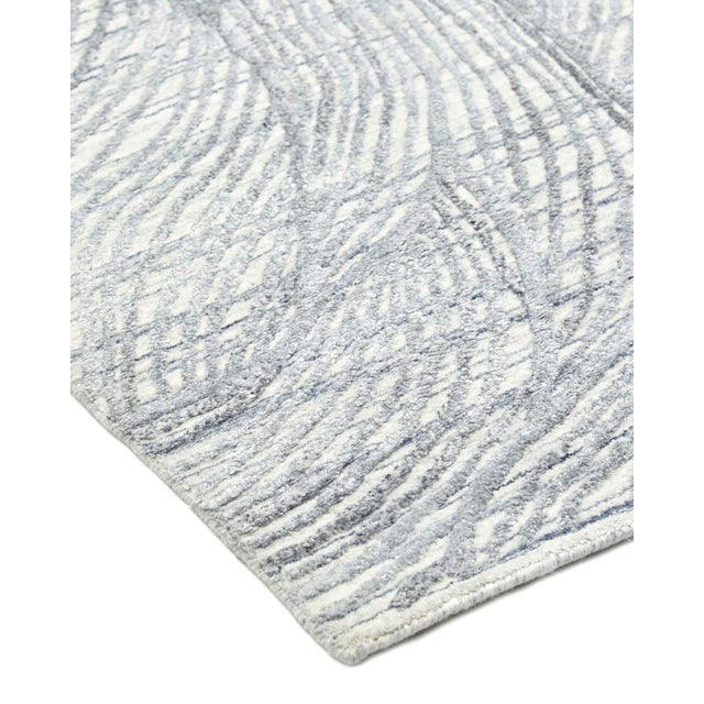 Color: Mist. Made in: India. Fresh, spirited, and above all, luxurious, the rugs of the Modern collection can invigorate a...