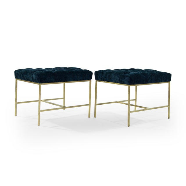 Pair of brushed brass stools or benches, newly upholstered in navy chenille with tufted detail, circa 1950s.