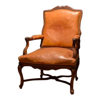 19th Century French Walnut Armchair in the Style of a Louis Xvi. This Chair Is Nicely Carved With Intricate Detail, Cabriole Legs and Tanned Leather. For Sale