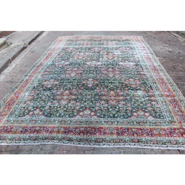 Antique large Persian Kerman rug in the colors of everrgreeen, moss green, aqua blue, and raspberry. Rug has been shaved...