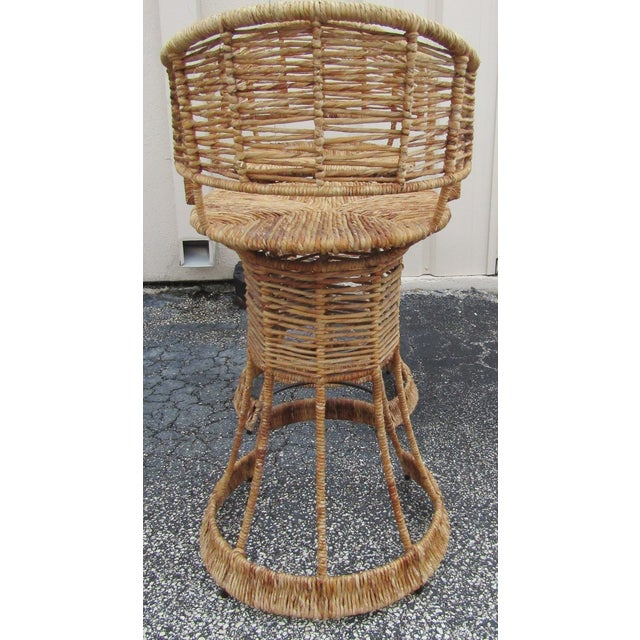 Words cannot describe accurately how spectacular this pair of vintage stools are. The pair are vintage, and the wicker,...